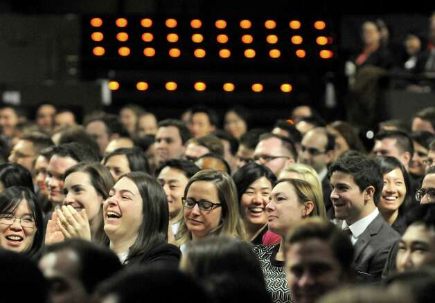 Newly admitted members of the New York State Bar react to the speaker, Presiding Justice Karen K. Peters, during a swearing-in ceremony at the Empire State Plaza Convention Center on Thursday Jan. 22, 2015 in Albany, N.Y. (Michael P. Farrell/Times Union) Photo: Michael P. Farrell / 00030281A