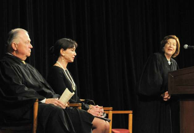 Presiding Justice of the Third Department Karen K. Peters, right, introduces Justices Eugene P. Devine and A. Gail Prudenti, Chief Administrative Judge of the Courts, during a swearing in ceremony for newly admitted members of the New York State Bar at the Empire State Plaza Convention Center on Thursday Jan. 22, 2015 in Albany, N.Y. (Michael P. Farrell/Times Union) Photo: Michael P. Farrell / 00030281A