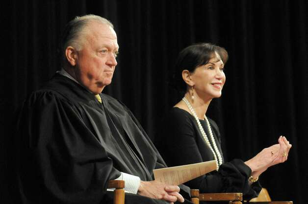 Justices Eugene P. Devine, left, and A. Gail Prudenti, Chief Administrative Judge of the Courts, during a swearing-in ceremony for newly admitted members of the New York State Bar at the Empire State Plaza Convention Center on Thursday Jan. 22, 2015 in Albany, N.Y. (Michael P. Farrell/Times Union) Photo: Michael P. Farrell / 00030281A