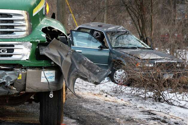 A Davey tree service truck and a passenger car involved in an accident at the intersection of Menand and Schuyler Roads Thursday Jan. 22, 2015, in Colonie, NY.  (John Carl D'Annibale / Times Union) Photo: John Carl D'Annibale