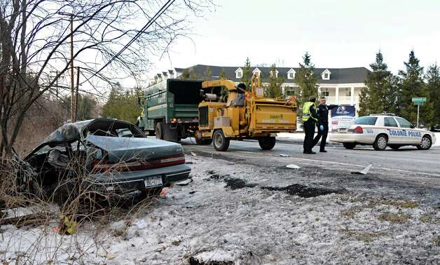 Colonie police investigate an accident between a Davey tree service truck and a passenger car at the intersection of Menand and Schuyler Roads Thursday Jan. 22, 2015, in Colonie, NY.  (John Carl D'Annibale / Times Union) Photo: John Carl D'Annibale