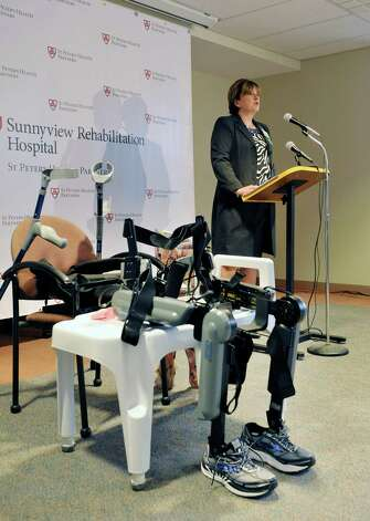 The ReWalk exoskeleton suit is seen on display as Dr. Lynne Nicolson, chief medical officer at Sunnyview Rehabilitation Hospital talks about the technology  during an event at Sunnyview Rehabilitation Hospital on Thursday, Jan. 22, 2015, in Schenectady, N.Y.  The ReWalk exoskeleton suit uses a technology with motorized legs that power the knee and hip movements to help paraplegics and others with lower limb disabilities to walk again.  A computer based system uses motion sensors to control the leg movements in response to subtle changes in the upper body movements and shifts in balance.  Crutches are used for stability and a backpack worn by the patient holds the computer system and the battery that provides power to the suit.    (Paul Buckowski / Times Union) Photo: Paul Buckowski / 00030262A