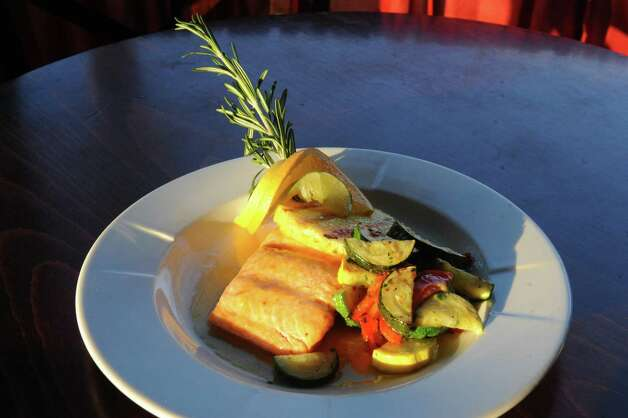 Citrus salmon with rustic grilled mixed vegetables at Clark's Steakhouse on Thursday Jan. 15, 2015 in Schuylerville, N.Y. (Michael P. Farrell/Times Union) Photo: Michael P. Farrell / 00030206A
