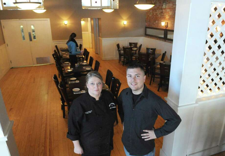 Jason Young, right, owner of Clark's Steakhouse with his executive chef Tina Marie Clements on Thursday Jan. 15, 2015 in Schuylerville, N.Y. (Michael P. Farrell/Times Union) Photo: Michael P. Farrell / 00030206A