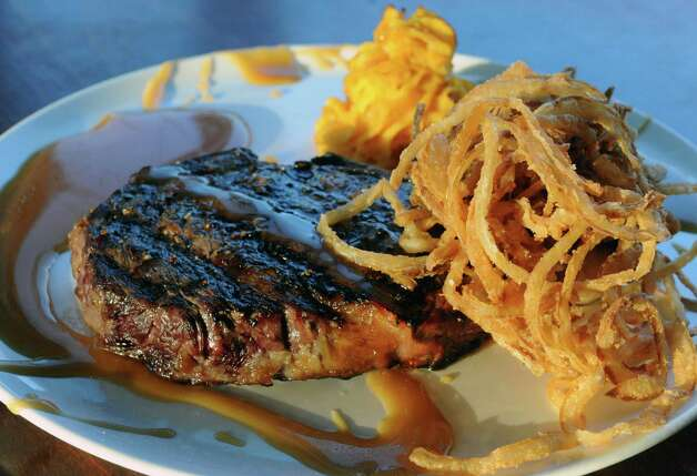Delmonico steak with a sweet bourbon glaze with a sweet potato mash at Clark's Steakhouse on Thursday Jan. 15, 2015 in Schuylerville, N.Y. (Michael P. Farrell/Times Union) Photo: Michael P. Farrell / 00030206A