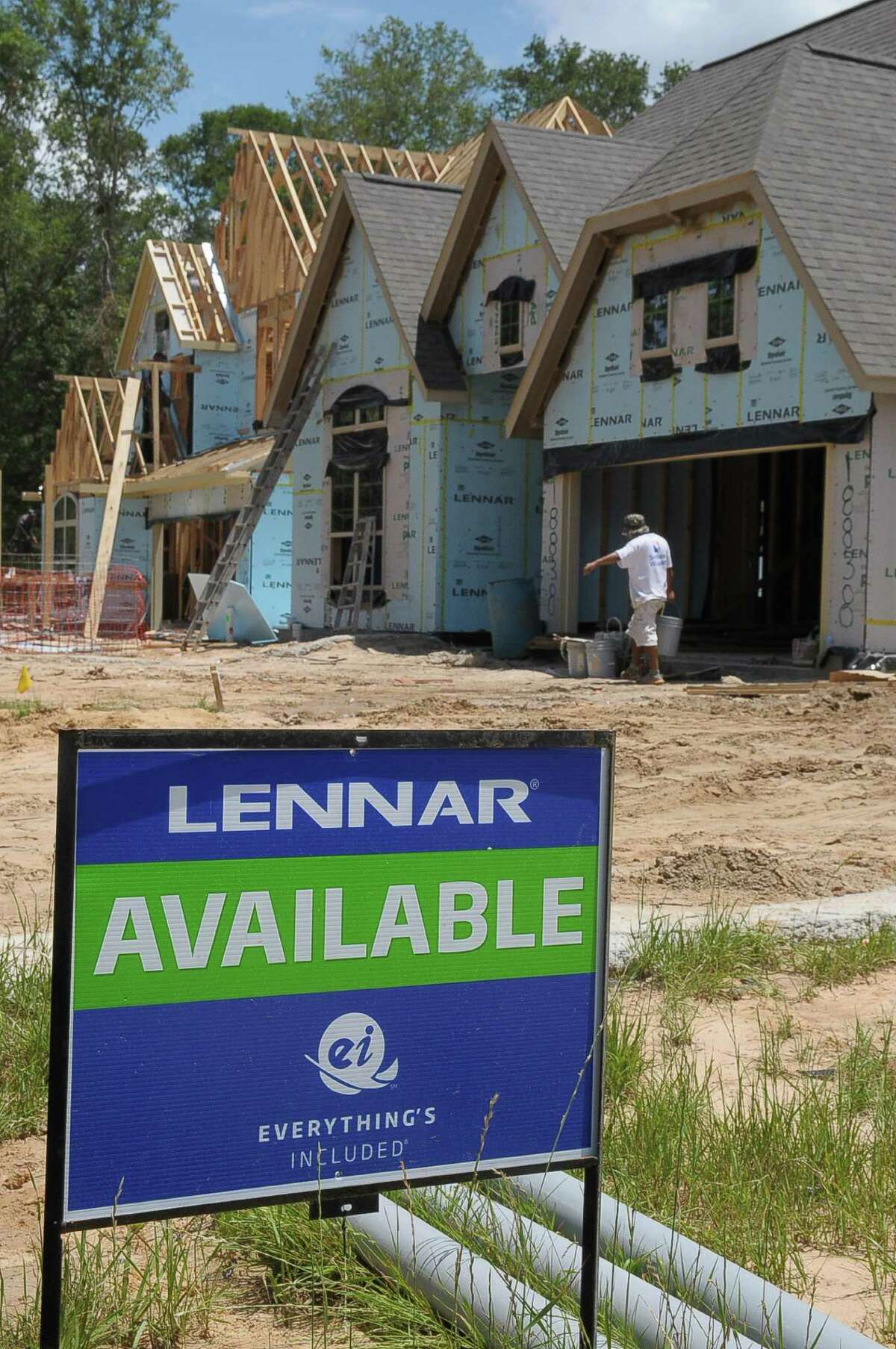 A leader in home construction sees a slight pullback in the area's higher-end housing.