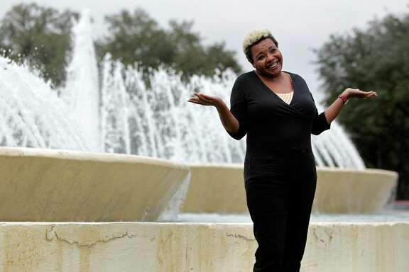 "Ruth Munoz throws up her hands when asked how did she become an ""Accidental Houstonian"". She is a student at the University of Houston, and enjoys the iconic Mecom Fountain in Hermann Park on Wednesday, Dec. 17, 2014, in Houston."