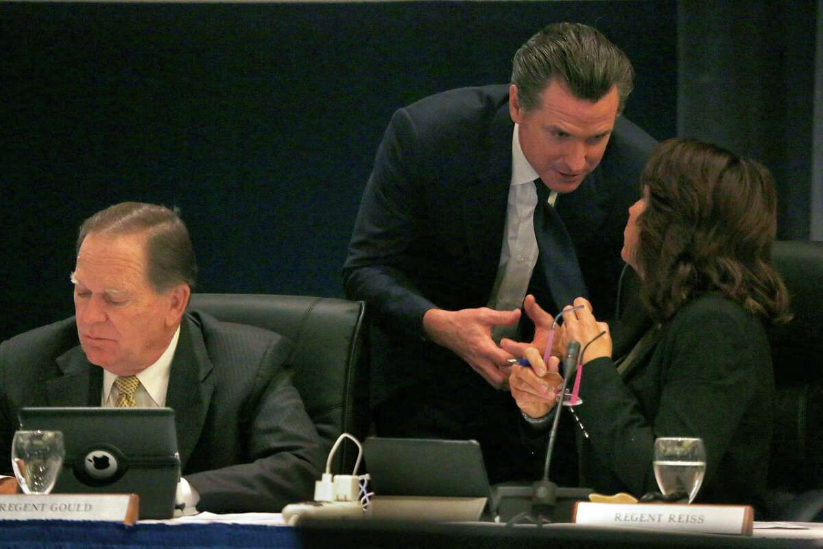 Lieutenant governor of California Gavin Newsom (middle) talks with Bonnie Reiss (right) before leaving the UCSF regents board meeting in San Francisco, Calif., on Wednesday, January 21, 2015. At left is regent Russell S. Gould.