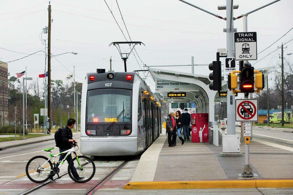 Commuters board a light rail train at the Northline Transit Center on Thursday. Metro, with federal money left over, is considering additional work along some of the new rail lines in the city.
