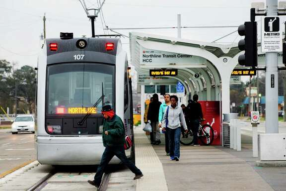 Commuters walk off a light rail train at the Northline Transit Center on Thursday, Jan. 22, 2015, in Houston. Metro, with federal money left over, is considering additional work along some of the new rail lines in the city. One of the plans, if approved, would before a better transit center at Northline Commons, the last stop north on the Red Line.