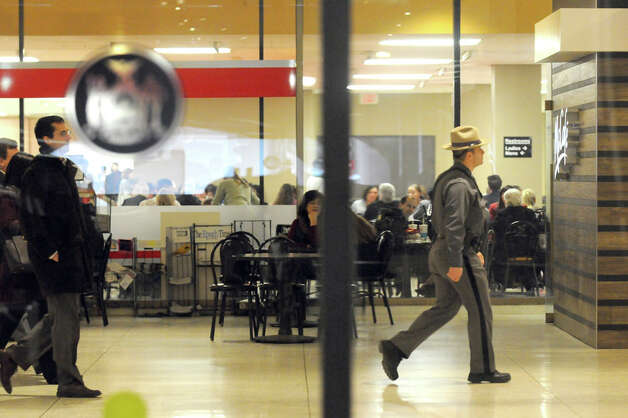A New York State Police Trooper patrols the Empire State Plaza Concourse on Thursday Jan. 22, 2015 in Albany, N.Y. (Michael P. Farrell/Times Union) Photo: Michael P. Farrell, Albany Times Union / 00030318A