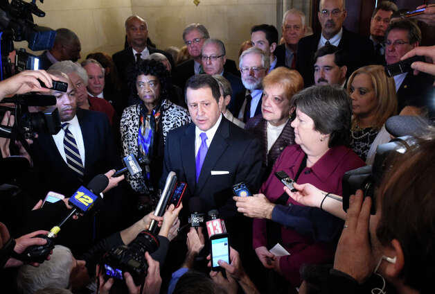Assembly Majority Leader Joseph Morelle, center, surrounded by members of the Democratic Conference  comments on Speaker Silver's legal situation Thursday morning Jan. 22, 2015 at the State Capitol in Albany, N.Y. as Assembly Speaker Sheldon Silver answers to charges in Federal Court in New York City.      (Skip Dickstein/Times Union) Photo: SKIP DICKSTEIN, ALBANY TIMES UNION / 00030317A