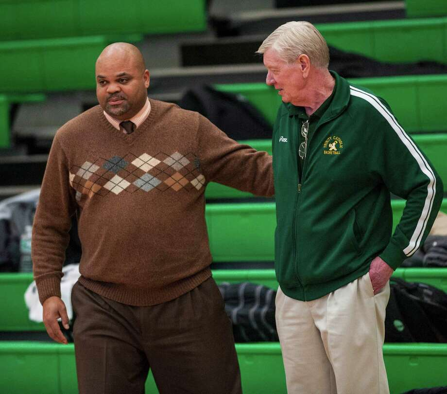 Kolbe Cathedral high school head coach Chris Smith and Trinity Catholic high school head coach Mike Walsh during a boys basketball game played at Trinity Catholic high school, Stamford, CT on Saturday, December 20th, 2014. Photo: Mark Conrad / Connecticut Post Freelance
