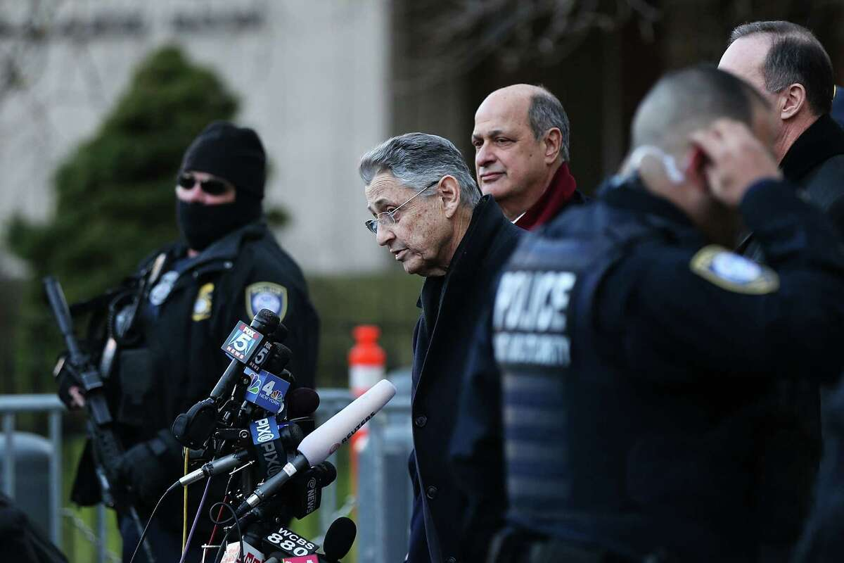 NEW YORK, NY - JANUARY 22: Speaker of the New York State Assembly, Sheldon Silver (2nd L), speaks to the media after walking out of a New York court house after being arrested on federal corruption charges on January 22, 2015 in New York City. Silver, a Democrat from the Lower East Side of Manhattan who has served as speaker for more than two decades, is accused in court documents of using the power of his office to solicit millions in bribes and kickbacks. (Photo by Spencer Platt/Getty Images) ORG XMIT: 533918707