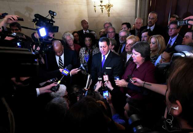 Assembly Majority Leader Joseph Morelle, center, surrounded by members of the Democratic Conference,  comments on Speaker Silver's legal situation Thursday morning, Jan. 22, 2015 at the State Capitol in Albany, N.Y.  (Skip Dickstein/Times Union) Photo: SKIP DICKSTEIN / 00030317A
