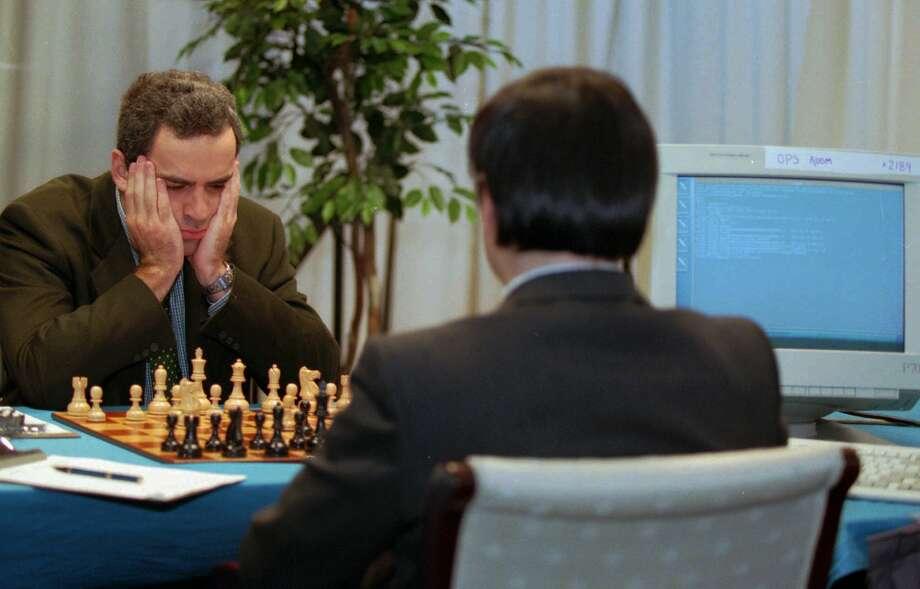 Chess champion Garry Kasparov (left) plays IBM's Deep Blue in the first of two matches. Kasparov won the first, Deep Blue the rematch. Photo: H. RUMPH, JR / Associated Press / AP
