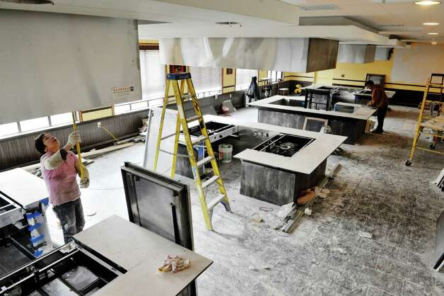 Work continues inside Akira, a new hibachi and sushi restaurant located at 385 Route 9W on Thursday, Jan. 22, 2015, in Glenmont, N.Y.  The restaurant will have a total of ten hibachi stations, with two of them being in a private room.    (Paul Buckowski / Times Union) Photo: Paul Buckowski / 00030305A