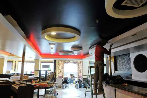 Work continues inside Akira, a new hibachi and sushi restaurant located at 385 Route 9W on Thursday, Jan. 22, 2015, in Glenmont, N.Y.    (Paul Buckowski / Times Union) Photo: Paul Buckowski / 00030305A