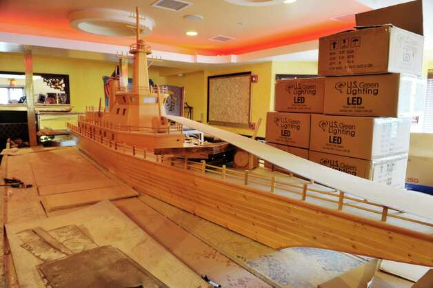 A model wooden boat is part of the decor inside Akira, a new hibachi and sushi restaurant located at 385 Route 9W on Thursday, Jan. 22, 2015, in Glenmont, N.Y.    (Paul Buckowski / Times Union) Photo: Paul Buckowski / 00030305A