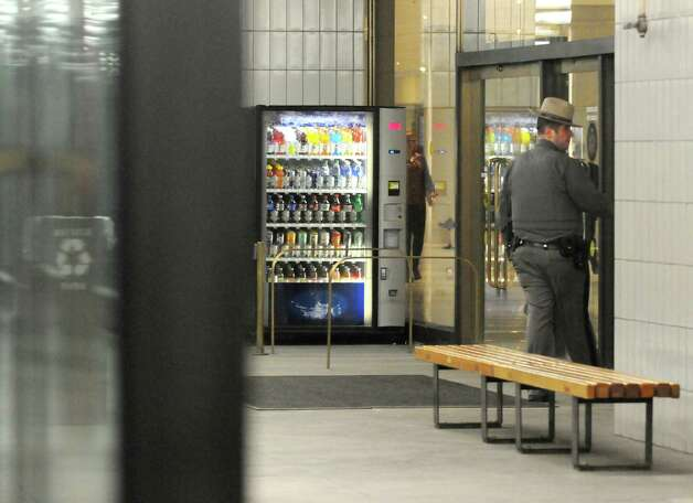 A New York State Police Trooper patrols the Empire State Plaza Concourse on Thursday Jan. 22, 2015 in Albany, N.Y. (Michael P. Farrell/Times Union) Photo: Michael P. Farrell / 00030318A