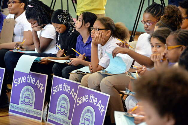 Ark 5th and 6th grade civics class students take notes during a press conference to support reopening The Ark charter school Tuesday May 27, 2014, in Troy, NY.  (John Carl D'Annibale / Times Union archive) Photo: John Carl D'Annibale / 00027057A