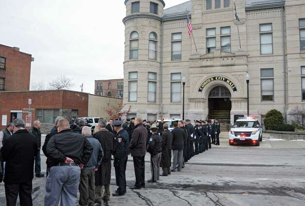 Members of the Cohoes Police Department, the Cohoes Fire Department, friends and family form an honor corridor for Assistant Police Chief Jim Ward to walk through outside Cohoes City Hall on Thursday, Jan. 22, 2015 in Cohoes, N.Y.  Ward is retiring after 32 years with the police department. (Lori Van Buren / Times Union) Photo: Lori Van Buren / 00030298A