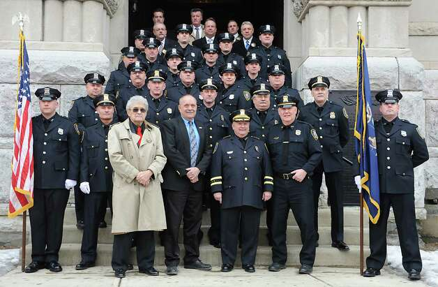 Assistant Police Chief Jim Ward, third from right, has his photo taken with members of the Cohoes Police Department on the front steps outside Cohoes City Hall on Thursday, Jan. 22, 2015 in Cohoes, N.Y. Ward is retiring after 32 years with the police department. (Lori Van Buren / Times Union) Photo: Lori Van Buren / 00030298A