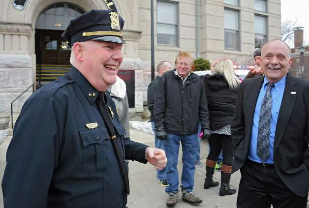 Assistant Police Chief Jim Ward, left, laughs with Cohoes Mayor George Primeau, right, after members of the Cohoes Police Department, the Cohoes Fire Department, friends and family formed an honor corridor for him to walk through outside Cohoes City Hall on Thursday, Jan. 22, 2015 in Cohoes, N.Y. Ward is retiring after 32 years with the police department. (Lori Van Buren / Times Union) Photo: Lori Van Buren / 00030298A