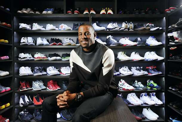 Andre Iguodala in the walk-in shoe closet of his East Bay home, wearing a Neil Barrett sweatshirt and black Dior jeans.