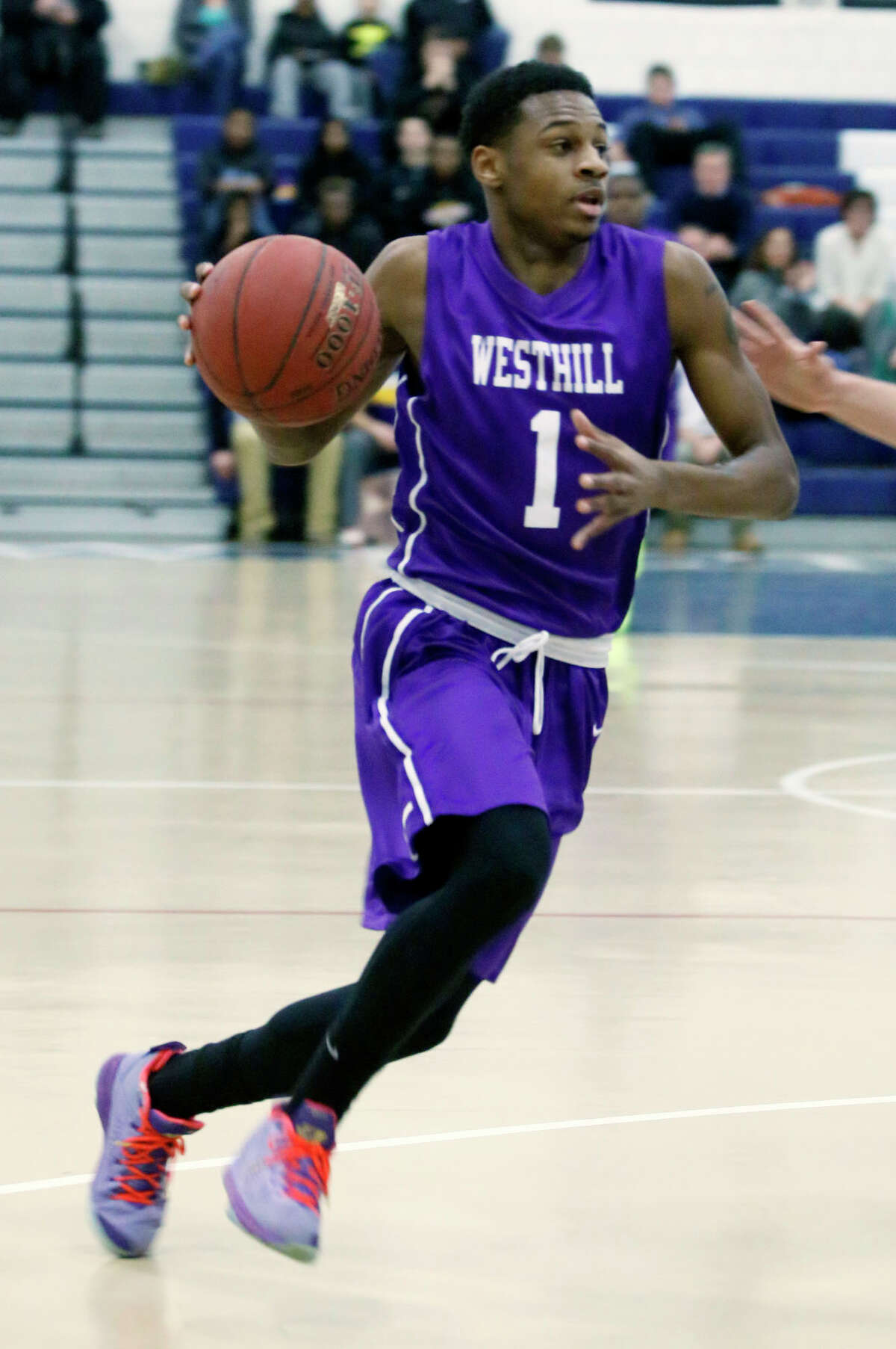 Westhill's Jeremiah Livingston drives to the basket during the Vikings' basketball game against Wilton at Wilton High School in Wilton, Conn., on Thursday, Jan. 22, 2015. Westhill won, 72-67.
