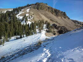 The view of 9,103-foot Castle Peak from Castle Pass, located across Interstate 80 from Boreal Ski Area near Donner Summit, shows the low snow conditions in the area.