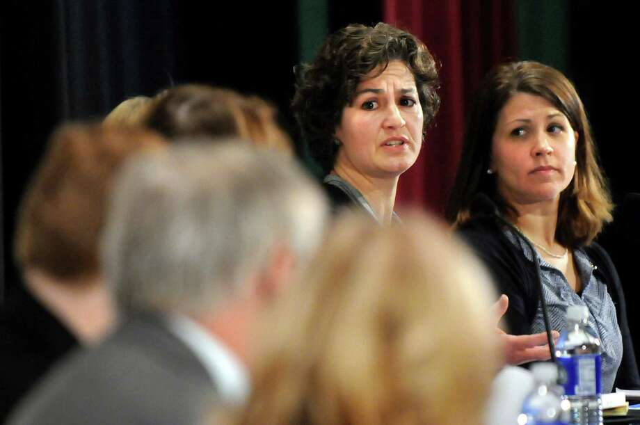 Nicole Clarke, a parent in the Galway Central School District, second from right, speaks during Stand Up for Upstate Schools on Thursday, Jan. 222, 2015, at Saratoga Springs High in Saratoga Springs, N.Y. At right is Cindy Bartlett-Murray, teacher with the Queensbury Union Free School District. (Cindy Schultz / Times Union) Photo: Cindy Schultz / 00030203A