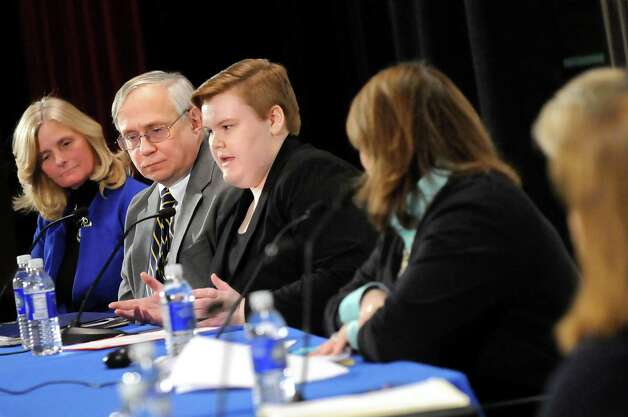 Allison Lanfear, a student at Warrensburg Central School District, center, speaks during Stand Up for Upstate Schools on Thursday, Jan. 222, 2015, at Saratoga Springs High in Saratoga Springs, N.Y. Also on the panel are Peggy A. Murphy of Espey Manufacturing and Electronics Corp., left, and Robert N. Lowry Jr. of the New York State Council of School Superintendents. (Cindy Schultz / Times Union) Photo: Cindy Schultz / 00030203A