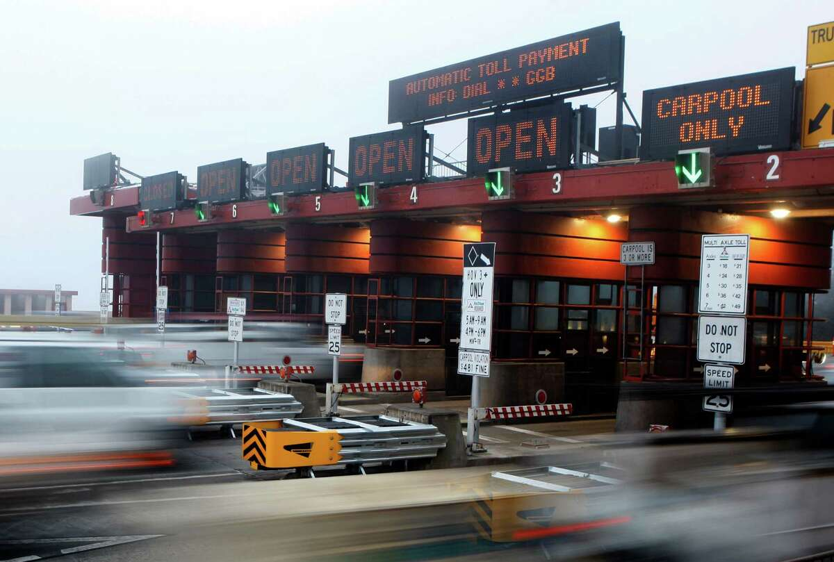 Vehicles rush through the Golden Gate Bridge Toll Plaza on Jan. 12 after the new barrier was installed.