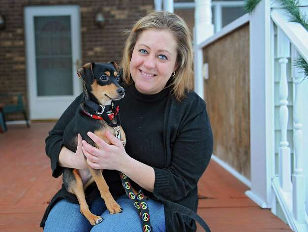 Michelle Maskaly sits with Maddux, her 7-month-old mixed breed puppy, on her front porch on Wednesday, Jan. 21, 2015 in Lake George, N.Y. The rescue dog will be staring in Animal Planet's 11th annual Puppy Bowl and is also featured on Animal Planet's Fantasy Draft Team. (Lori Van Buren / Times Union) Photo: Lori Van Buren / 00030297A