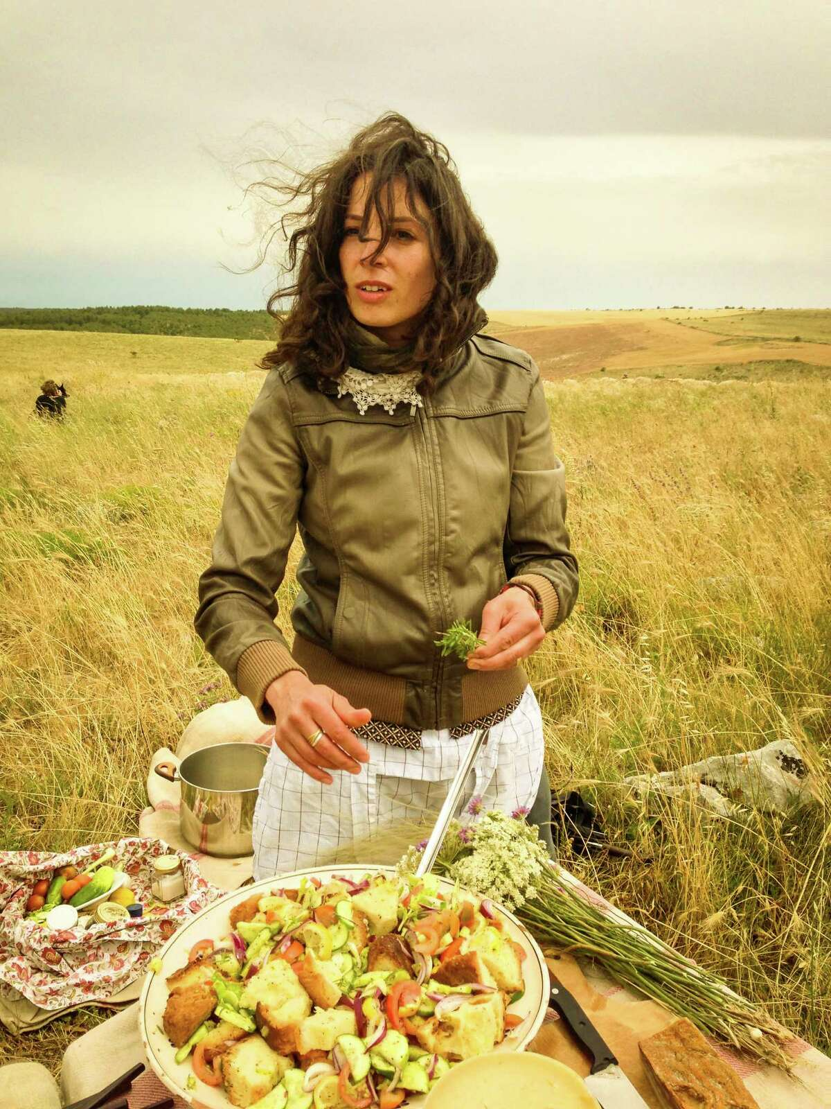 A simple shepherd-style lunch is assembled in the fresh air.