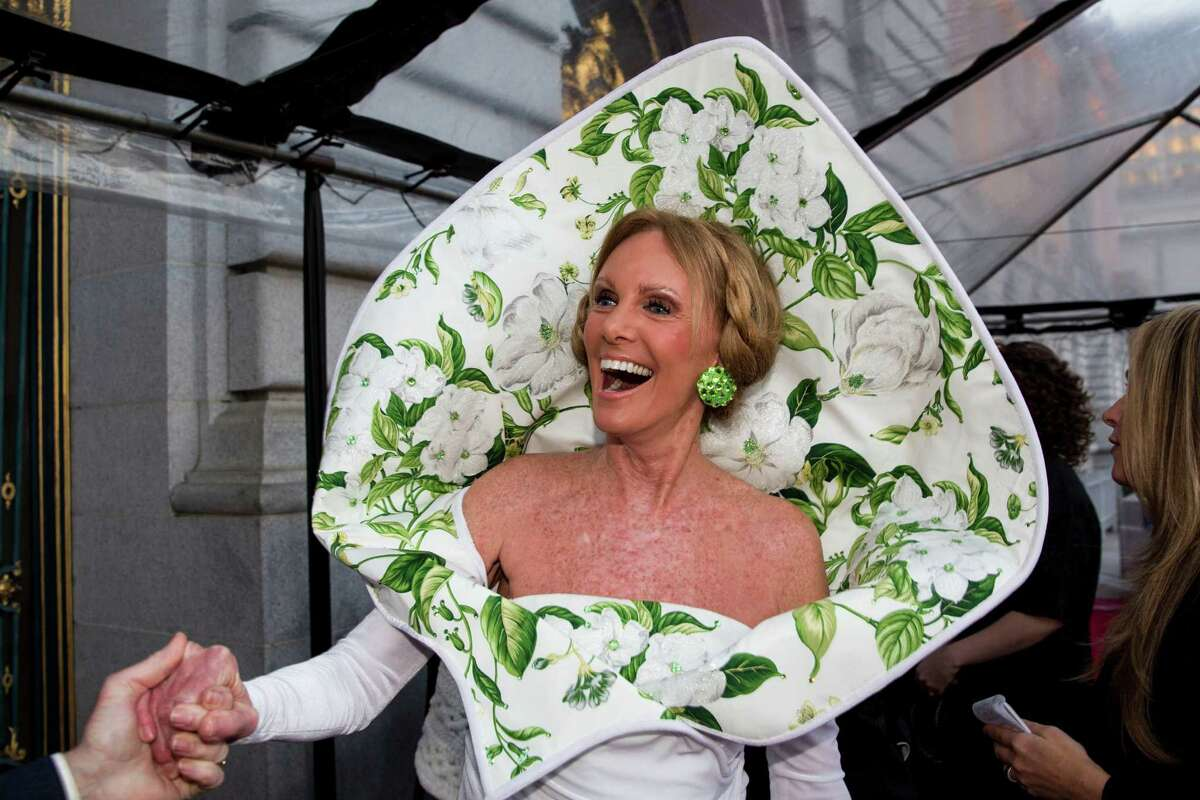 """Belinda Berry, known for her unusual and whimsical attire at San Francisco gala night functions, gets a compliment from another guest at the San Francisco Ballet 2015 Opening Night Gala on Jan. 22, 2015. The Memphis native, who worked as the Deputy Director of the San Francisco Passport Agency and is now retired in Walnut Creek, enjoys what she calls """"festoonery"""" on gala night. Her custom-designed gown was inspired by a Calla Lily Barbie doll given to her by a friend. Love or hate the look, one thing is clear: She doesn't take herself too seriously."""