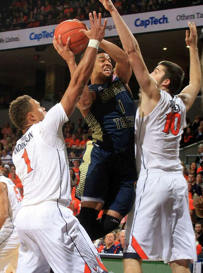 Georgia Tech guard Tadric Jackson (1) tries to shoot between Virginia's Justin Anderson (1) and Mike Tobey (10) during an NCAA college basketball game Thursday, Jan. 22, 2015, in Charlottesville, Va. (AP Photo/Andrew Shurtleff) ORG XMIT: VAAS102 Photo: ANDREW SHURTLEFF / FR82550 AP