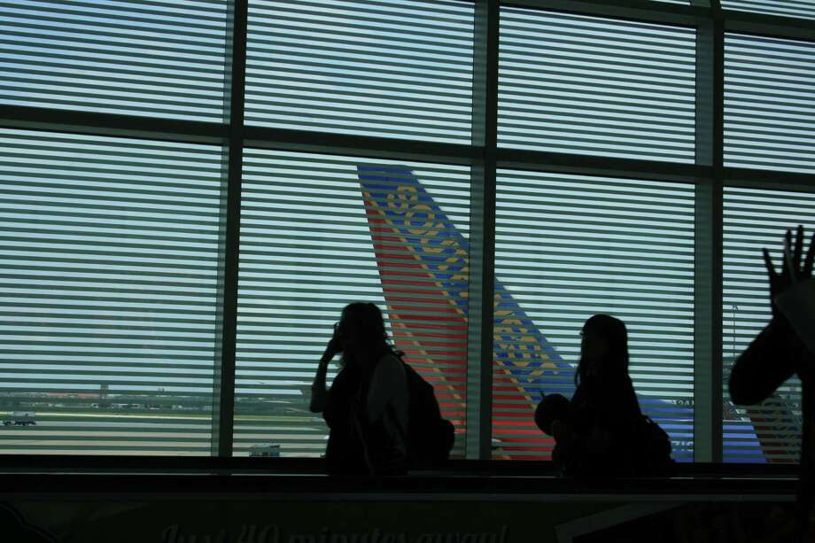 Passengers leave the gate area in May 2014 at Hobby Airport. Photo: Bill Montgomery