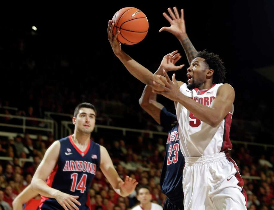 Stanford's Chasson Randle (5), shooting against Arizona on Thursday, leads the Pac-12 in scoring. Photo: Marcio Jose Sanchez / Associated Press / AP