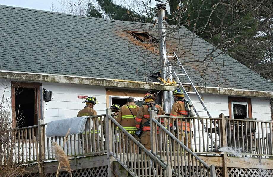 Firefighters work on a house fire at 916 Delaware Ave. on Thursday, Jan. 22, 2015 in Delmar, N.Y. (Lori Van Buren / Times Union) Photo: Lori Van Buren / 00030323A