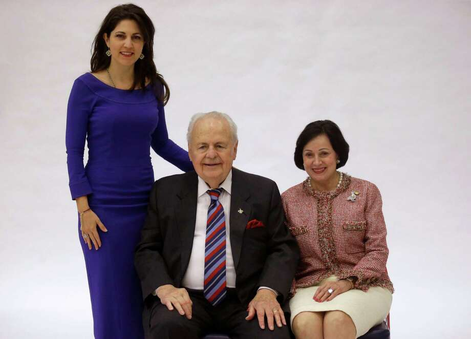 New Orleans Saints owner Tom Benson and his wife, Gayle Benson (right), pose for a photo with his granddaughter and Pelicans co-owner Rita Benson LeBlanc at the Pelicans NBA basketball media day last September. Photo: Associated Press File Photo / AP