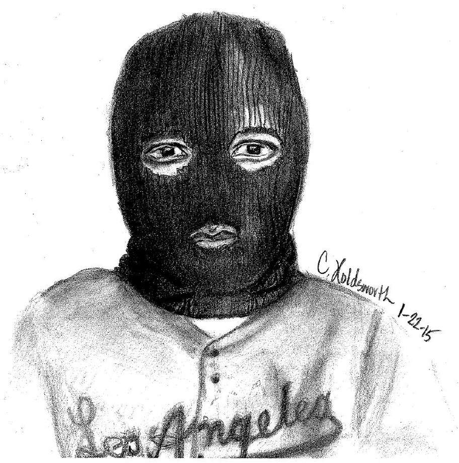 Rosenberg police say that this man – who apparently loved the Los Angeles Dodgers, despite having a cold face in need of covering – robbed a man in an apartment parking lot at gunpoint as the victim was removing his daughter from the car. Photo: Rosenberg Police