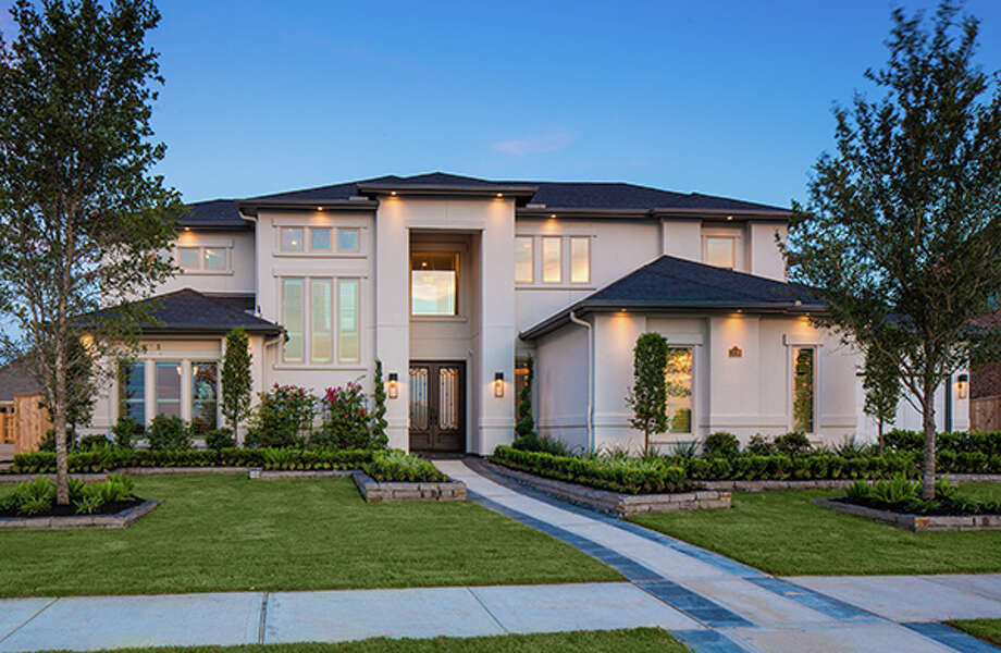In the gated neighborhood of Ironwood Estates, Cinco Ranch has luxury homes by Partners In Building (shown) and Toll Brothers. / ©2013 Steve Chenn Photography