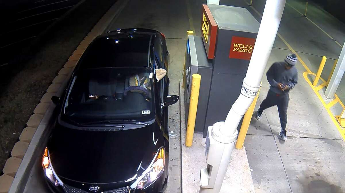 The Arlington Police Department has released security camera footage showing an alleged robbery and kidnapping suspect stuffing a female victim into the trunk of her own car at a Wells Fargo bank last week. The woman told police that the unknown male suspect ordered her to take money from her account at gunpoint before forcing her into the trunk while she sat at the bank's drive-thru ATM at around 3 a.m. on Jan. 14, according to an Arlington police news release.