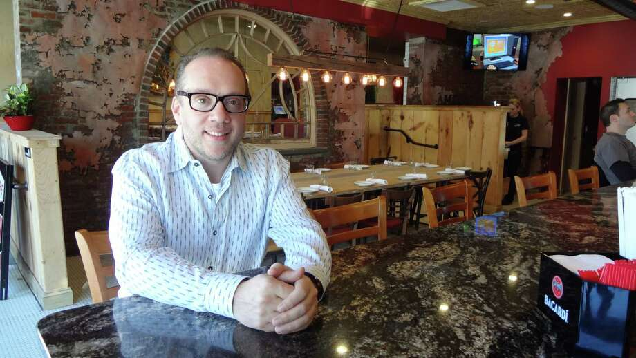 With Amore Cucina & Bar in Stamford, Bruno DiFabio has come back home to the place where he learned to toss dough before opening pizzerias across the country. Photo: Alexander Soule / Stamford Advocate