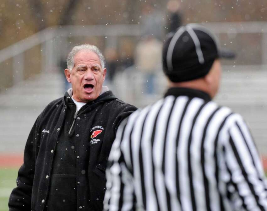 Greenwich High School football coach Rich Albonizio hollars at a referee during the Thanksgiving Day high school football game between Greenwich High School and Staples High School at Greenwich, Conn., Thursday, Nov. 27, 2014. Staples defeated Greenwich by a score of 38-21.