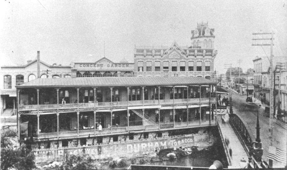 The building in the foreground was home to the San Antonio Express between 1890-1895. The building was on the San Antonio River front at Losoya. In the background, behind the Express building is the Dullnig Building (tower) and the Schulz Palm Garden (center). Photo: Express-News File Photo
