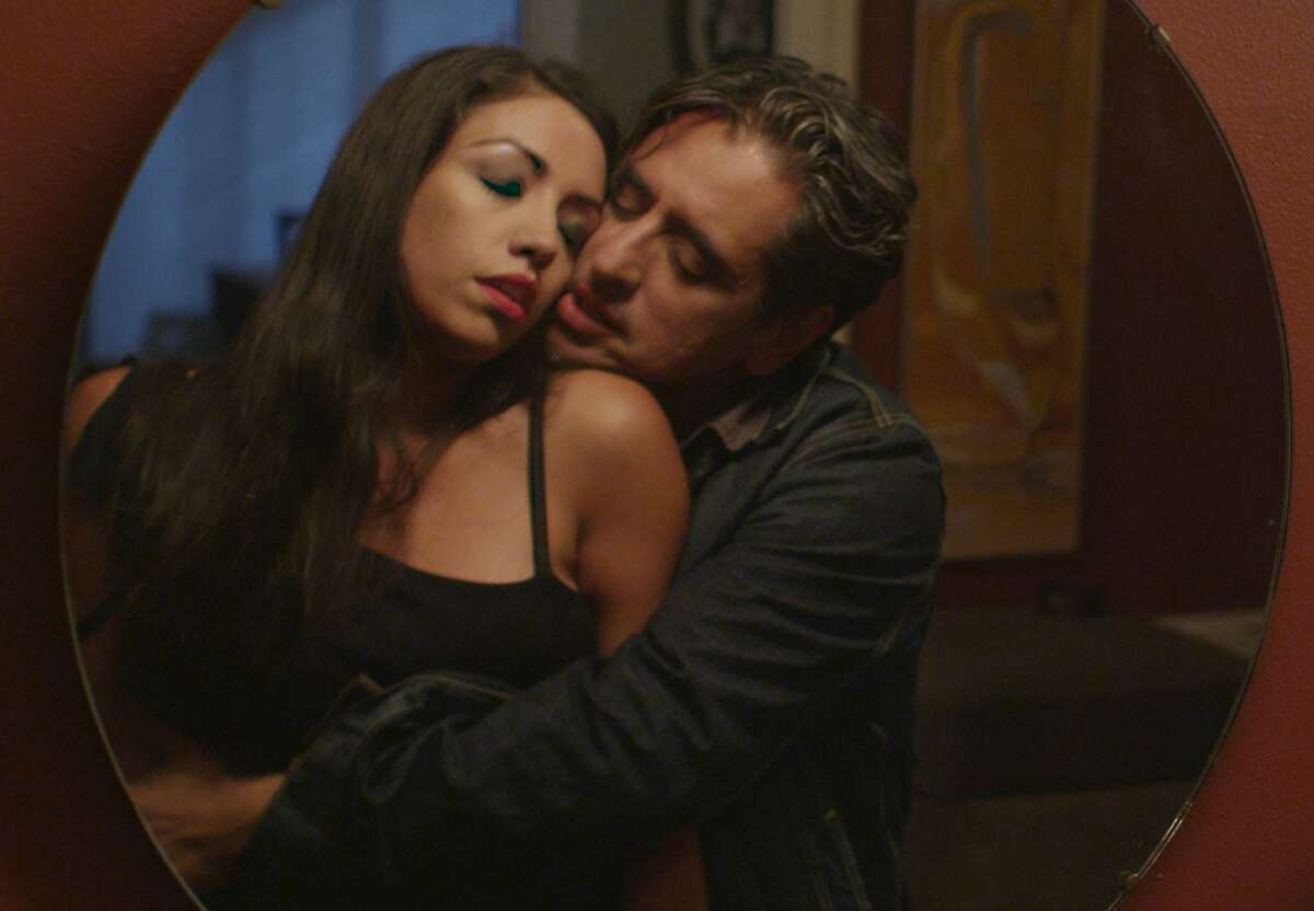 """Veronica Valencia as Sofia Nido and Richard Montoya as Roberto Morales in a scene from """"The Other Barrio"""" playing at 2015 SF Indiefest,"""