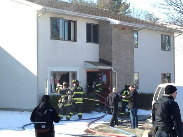 No one was injured when fire damaged the kitchen of a student apartment at the University at Albany on Friday. The fire was reported shortly after noon at the Freedom Apartments on Fuller Road in Albany. (Skip Dickstein / Times Union)
